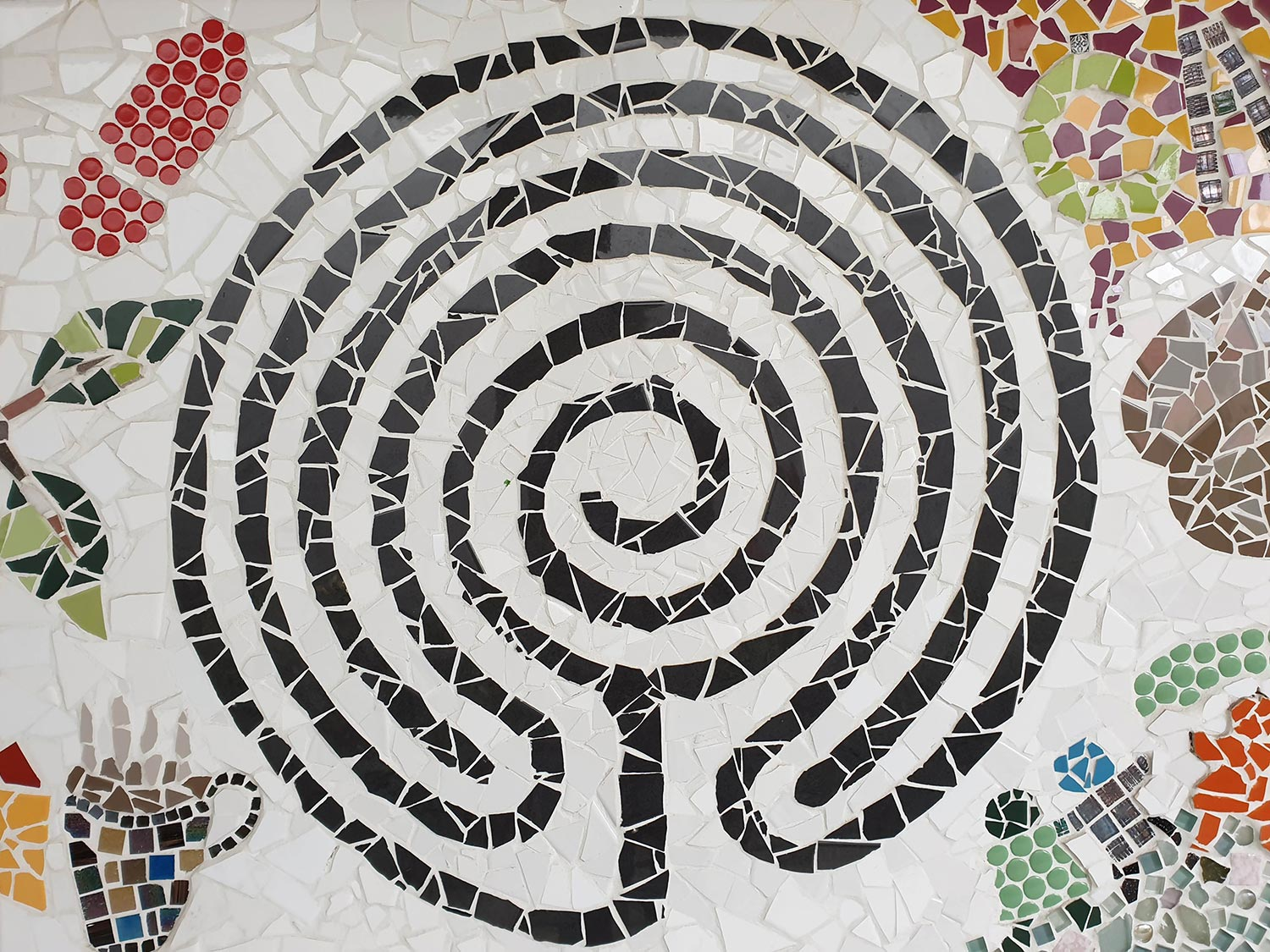 Detail of Jesmond Park UCA mosaic mural showing labyrinth design